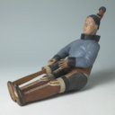 Model of an Inuit woman using a 'Kameo' to soften her sealskin boots