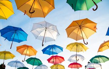 colourful umbrellas in the sky